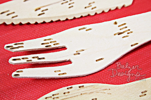 from the Balzer Designs Blog: Wood Burned Cutlery