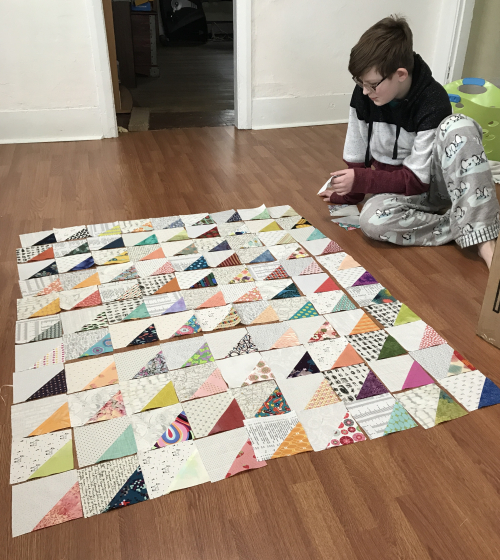 S laying out quilt